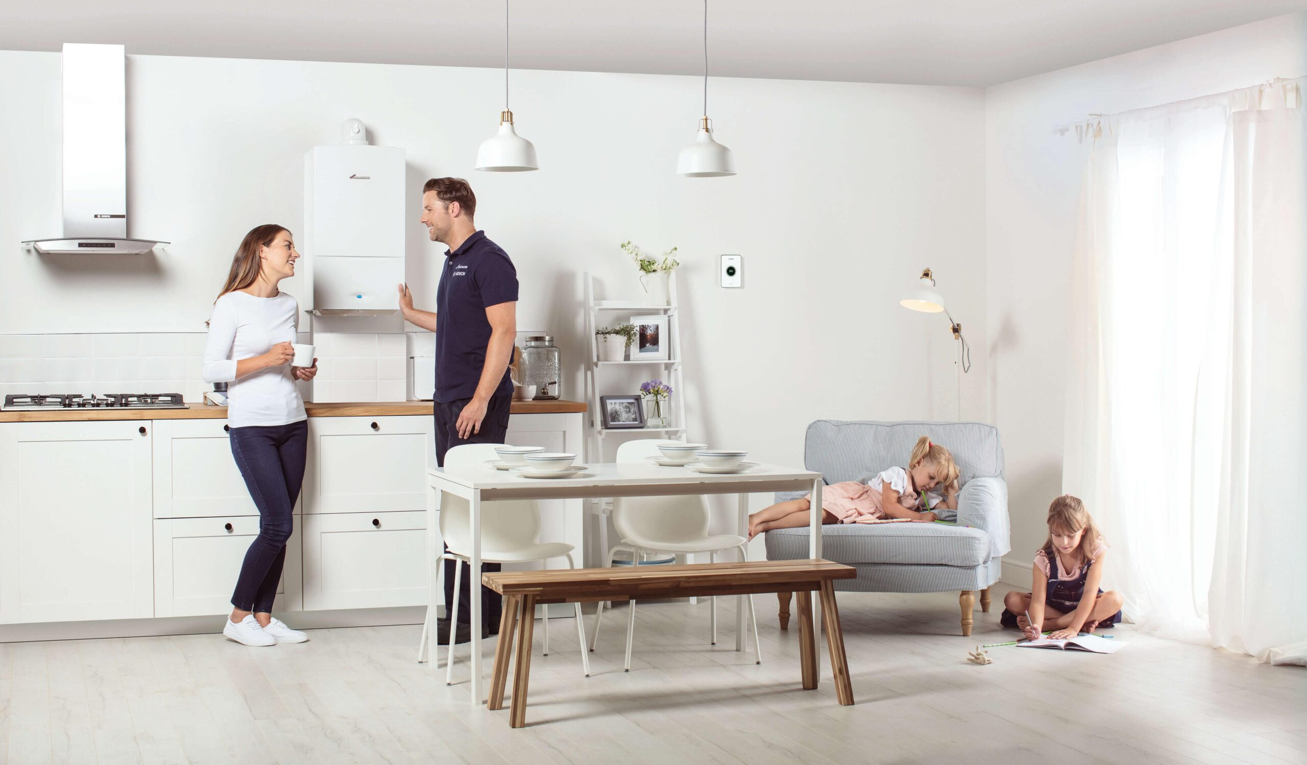 Heating Engineer in Saltash: Image of a a family and a heating engineer.
