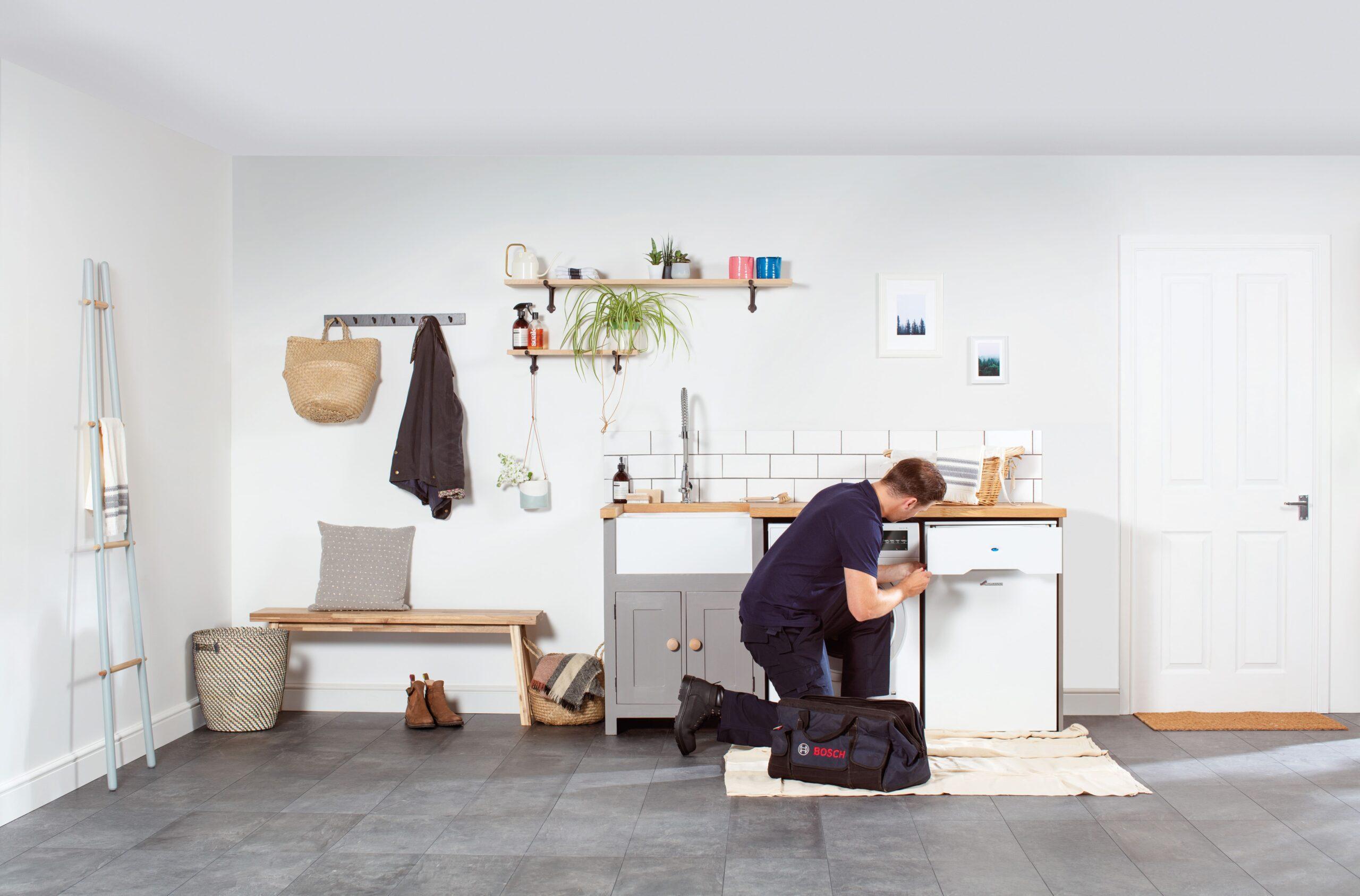 Heating Engineer in Plympton: Image of a heating engineer fitting an oil boiler.
