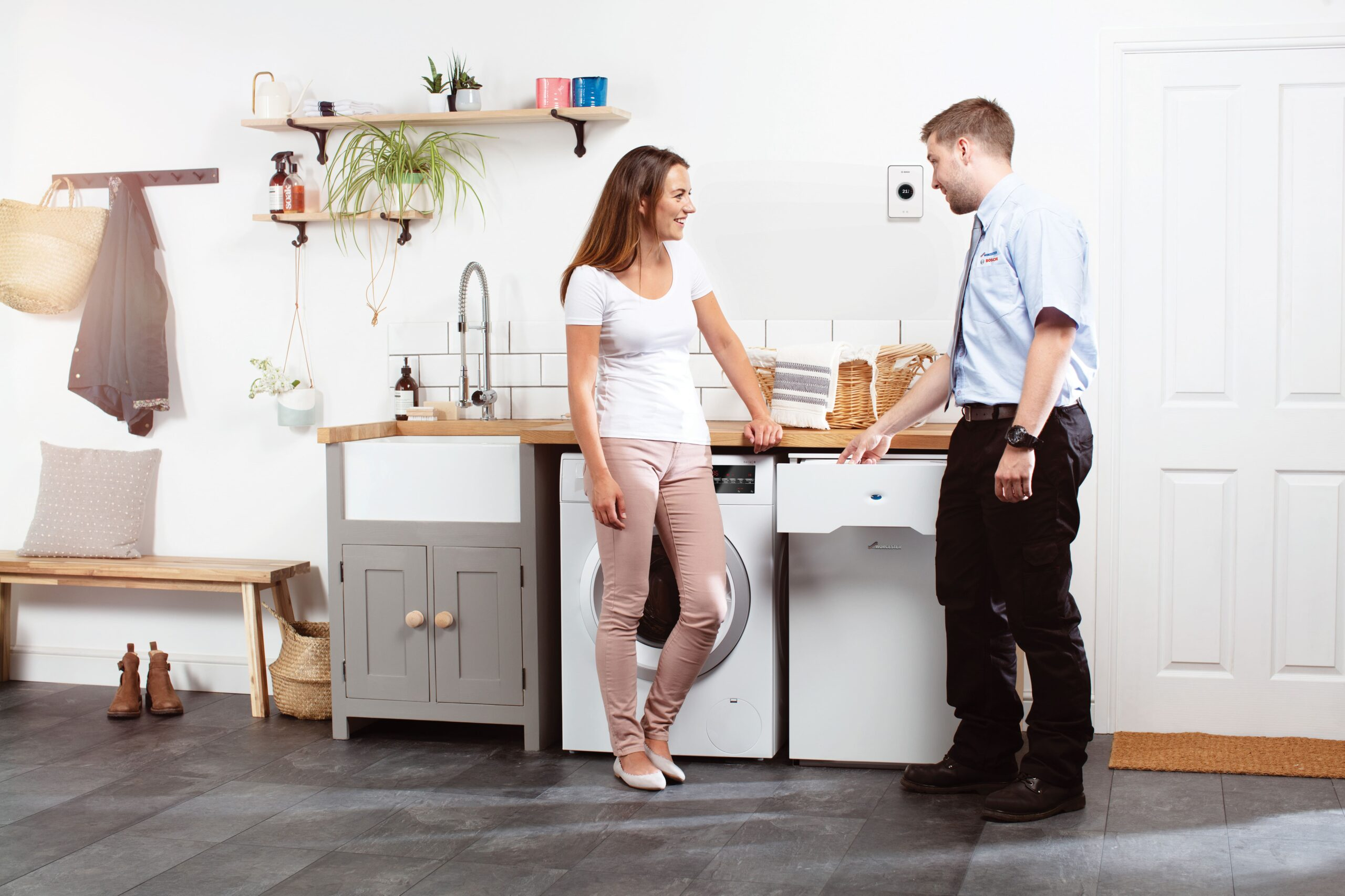 Heating Engineer in Plymstock: Image of a heating engineer with a customer.