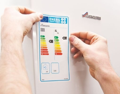 Heating Engineer in Torpoint: Image of a heating engineer applying an energy rating sticker to a boiler.